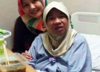 Almarhuman dr. Pupu Sari Rohayati MH, Kes (Biru muda)